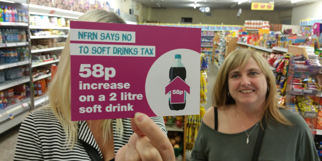 Customers holding up canthetax postcards